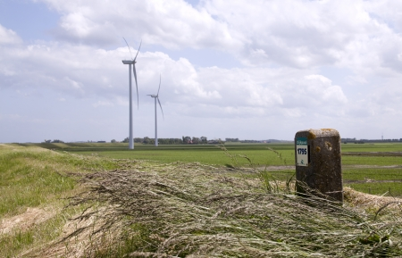 watermanagement: Mile stone at a dike in Holland