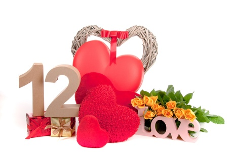 Number of age in a colorful studio setting with heart and gifts and yellow roses photo