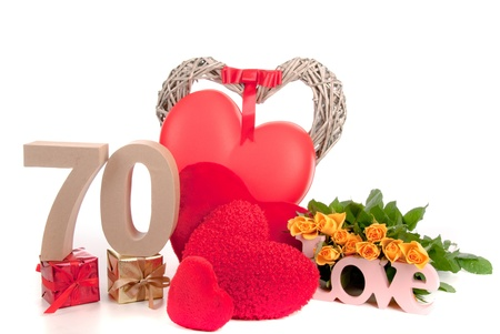 Number of age in a colorful studio setting with heart and gifts and yellow roses