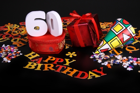 60 years: Happy birthday on a black background  and a red heart  and white caracters and confetti