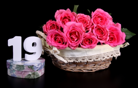 Number of age in a colorful studio setting with pink roses against a black background Stock Photo - 18290296