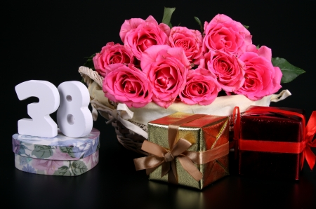 Number of age in a colorful studio setting with pink roses against a black background Stock Photo - 18291319