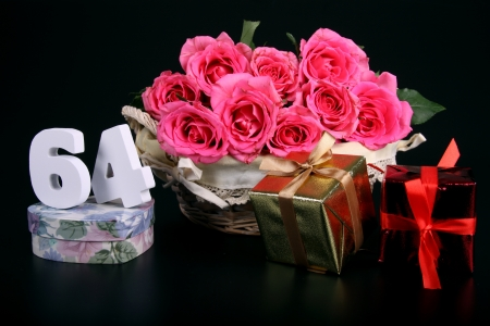 Number of age in a colorful studio setting with pink roses against a black background Stock Photo - 18291262