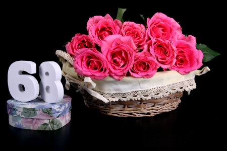 Number of age in a colorful studio setting with pink roses against a black background Stock Photo - 18291515