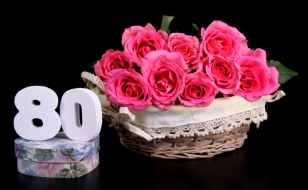 pinkcream: Number of age in a colorful studio setting with pink roses against a black background Stock Photo