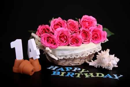 Number of age in a colorful studio setting with pink roses against a black background Stock Photo - 18744856
