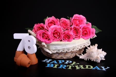 Number of age in a colorful studio setting with pink roses against a black background Stock Photo - 18744811