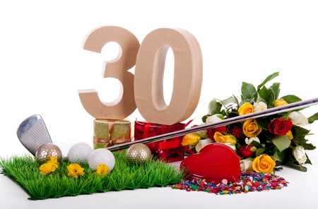Roses, a golf club and golf balls on an artificial peace of grass to be used as a birthday card Stock Photo - 18744619