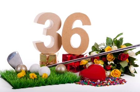 Roses, a golf club and golf balls on an artificial peace of grass to be used as a birthday card Stock Photo - 18744629