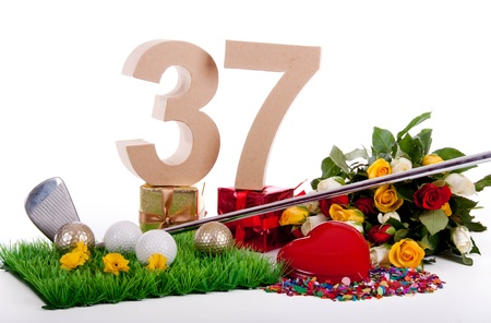 Roses, a golf club and golf balls on an artificial peace of grass to be used as a birthday card Stock Photo - 18744539