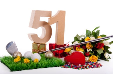 Roses, a golf club and golf balls on an artificial peace of grass to be used as a birthday card Stock Photo - 18744559