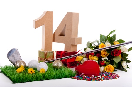 number 14: Roses, a golf club and golf balls on an artificial peace of grass to be used as a birthday card Stock Photo