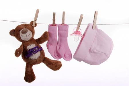 Babykleertjes op een waslijn
