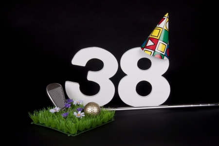 38: A golf club and golf ball on an artificial peace of grass to be used as a birthday card Stock Photo