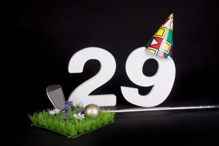 20 29: A golf club and golf ball on an artificial peace of grass to be used as a birthday card Stock Photo