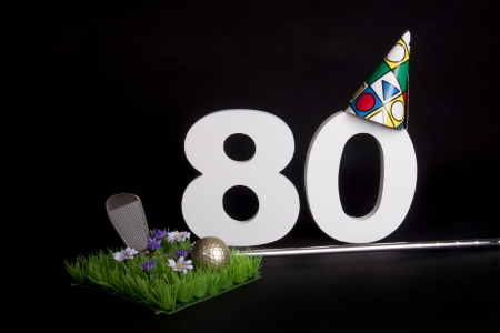 eighty: A golf club and golf ball on an artificial peace of grass to be used as a birthday card Stock Photo