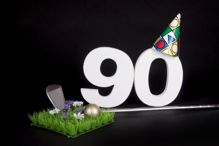 A golf club and golf ball on an artificial peace of grass to be used as a birthday card Stock Photo