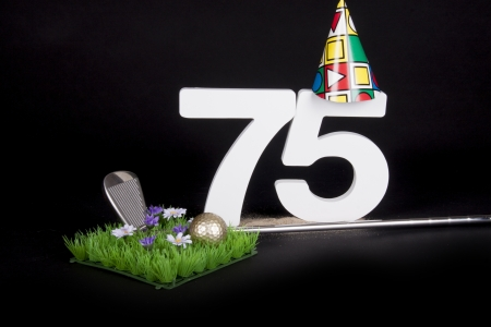 70 75: A golf club and golf ball on an artificial peace of grass to be used as a birthday card Stock Photo