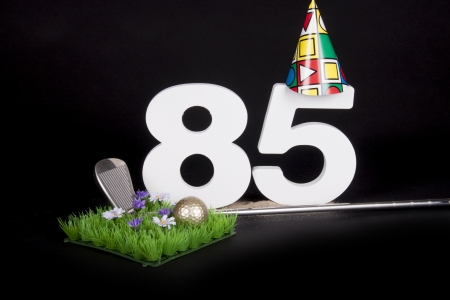 80 85: A golf club and golf ball on an artificial peace of grass to be used as a birthday card Stock Photo