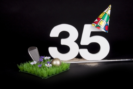age 30 35 years: A golf club and golf ball on an artificial peace of grass to be used as a birthday card Stock Photo