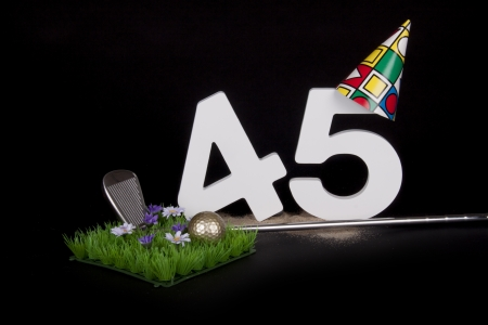 age 40 45 years: A golf club and golf ball on an artificial peace of grass to be used as a birthday card Stock Photo
