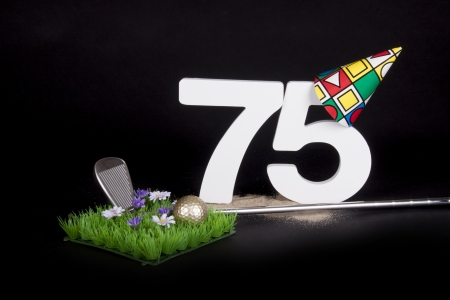 70 75 years: A golf club and golf ball on an artificial peace of grass to be used as a birthday card Stock Photo