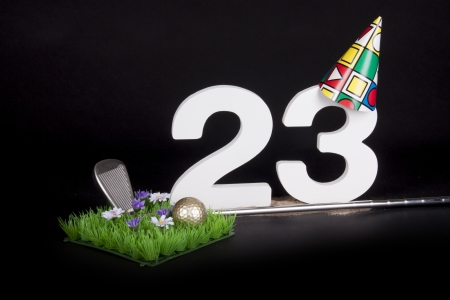 20 23 years: A golf club and golf ball on an artificial peace of grass to be used as a birthday card Stock Photo