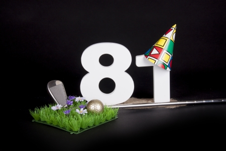 81: A golf club and golf ball on an artificial peace of grass to be used as a birthday card Stock Photo