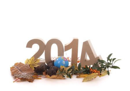 Jaar in de nummers met de herfst bladeren en andere producten voor het nieuwe jaar