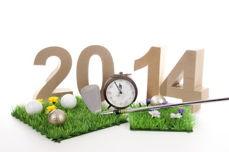 two thousand and fourteen: Golfstick and green symbolizes golfsport in the New year