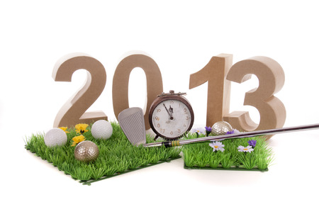 Golfstick and green symbolizes golfsport in the New year photo