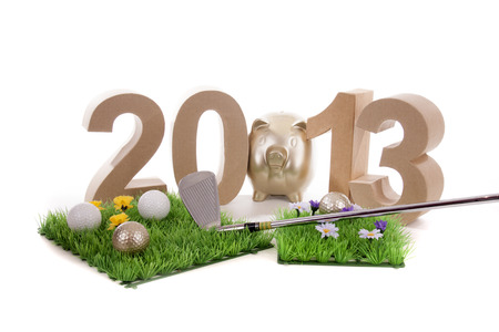 Golfstick and green symbolizes golfsport in the New year Stock Photo - 24051307