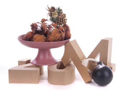 two thousand and fourteen: Oliebollen or Dutch donuts are made for consuming during New Years Eve