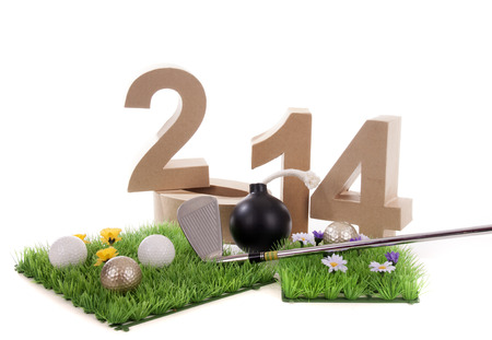 Golfstick and green symbolizes golfsport in the New year Stock Photo - 24480895