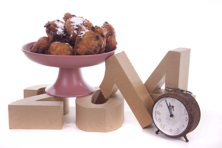 Oliebollen or Dutch donuts are made for consuming during New Years Eve Stock Photo - 24480931
