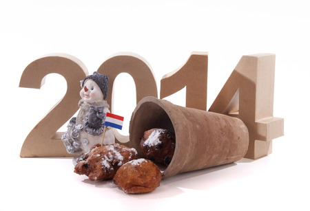 two thousand and fourteen: Dutch donuts in a pot with the year in numbers