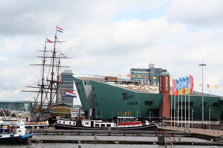 holland: Netherlands, Amsterdam,june 2016: Amsterdam NEMO Museum Building The four floors of NEMO Amsterdam is a stimulating scene.