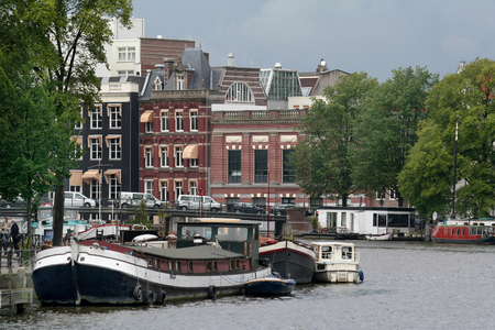 amstel river: Netherlands, Amsterdam,june 2016: The metropolis Amsterdam attracks yearly millions of tourists.