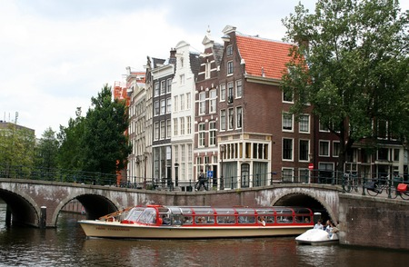 holland: Netherlands, Amsterdam, June 2016: A canalboat sails on the Keizersgracht, Editorial