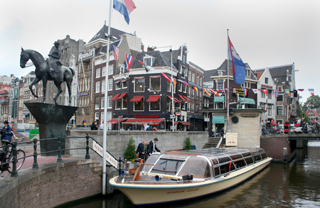 Netherlands, Amsterdam,june 2016: Moorage of canal-boats near  Oude Turfmarkt