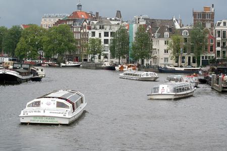 holland: Netherlands, Amsterdam,june 2016: Sailing along the house-boats