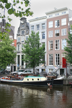 Netherlands, Amsterdam, June 2016: The Keizersgracht, one of the famous canals in Amsterdam contains stepped gabled houses Editorial