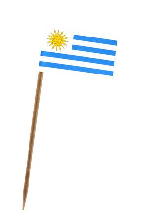 bandera de uruguay: Diente con una pequeña bandera de papel de Uruguay Foto de archivo
