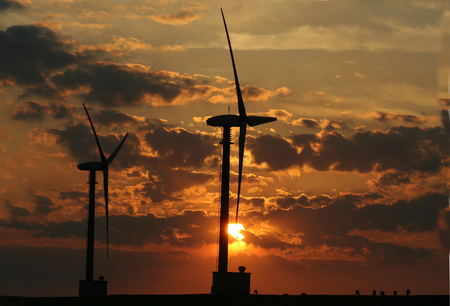 windturbines: Eemshaven,Groningen, july 2016: Windturbines against sunset in Eemshaven
