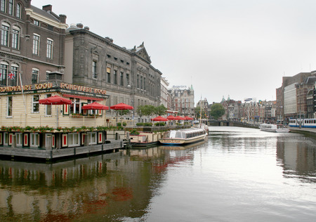 streetlife: Netherlands, Amsterdam,june 2016: Many canal-boats mooring at the Oude Turfmarkt
