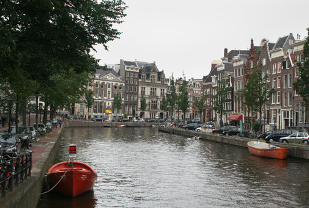 streetlife: Netherlands, Amsterdam,june 2016: The canals of Amsterdam attracks yearly many tourists Editorial