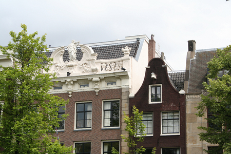 Netherlands, Amsterdam, June 2016: The façades of the houses on the Keizersgracht, showed the welth of te owner