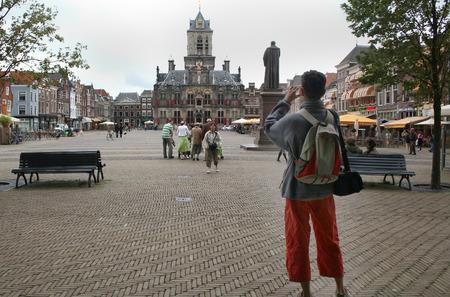 Delft, june 2016: Street, impression,city live, on the Market square Editorial