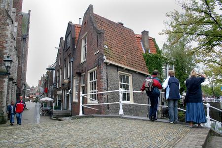 Delft, june 2016: Street, impression,city live,Tourists on a bridge