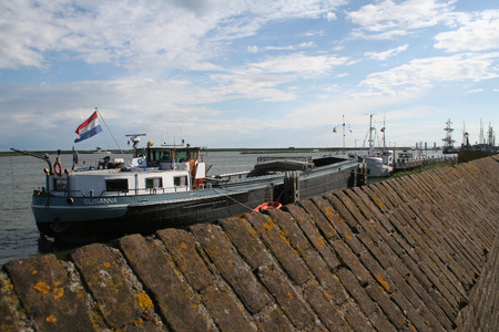 Netherlands, Enkhuizen june 2016: In the historical harbour many sailships are mooring
